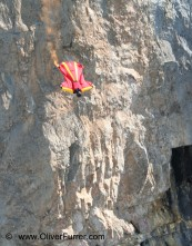 BASE jumper flying along a cliff