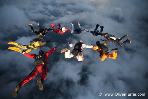 Skydive jump with friends RW holding hands