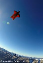 wingsuit pilots over the Swiss Alps