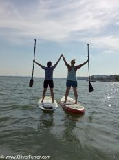 SUP paddeling along the shoreline on the lake Murten
