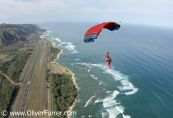 skydiver under canopy over the Oahu North Shore