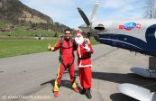 The santa Claus team by the plane