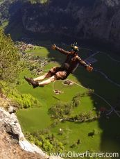 BASE jumper exit backward from a cliff