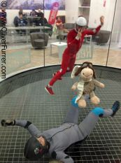 indoor skydivers are having fun fyling together